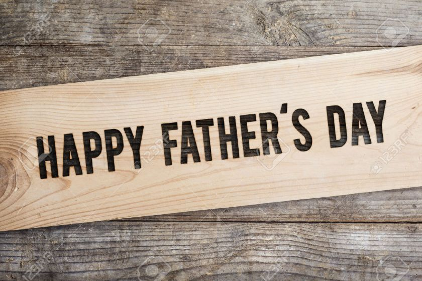 39900693-Happy-fathers-day-sign-on-wooden-boards-background--Stock-Photo